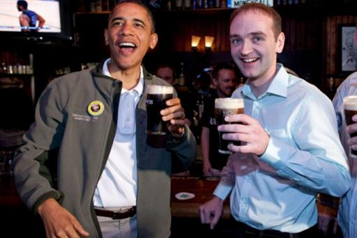 President Barack Obama visits the Dubliner, an Irish pub in Washington, D.C., with his Irish cousin, Henry Healy on March 17, 2012