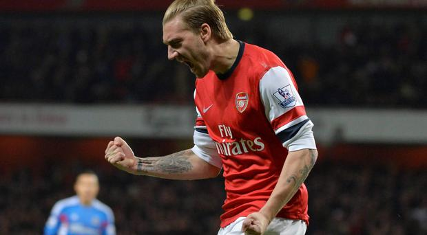 Arsenal's Nicklas Bendtner celebrates scoring in the very first minute of the game