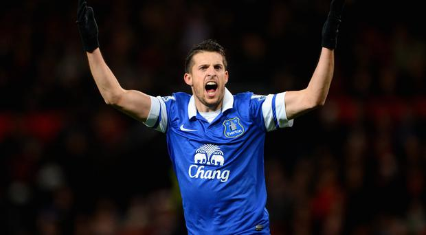 Kevin Mirallas of Everton celebrates after Bryan Oviedo scored his team's winner