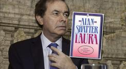 Alan Shatter and the cover of his racy novel 'Laura'