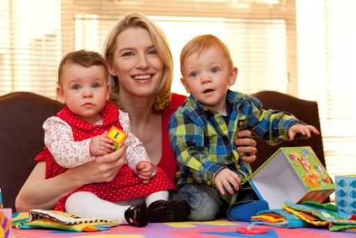 Helping Pamela Flood are 15 month old Caoimhe Farrell, Lucan and 16 month old Tommy Murphy, Carlow.
