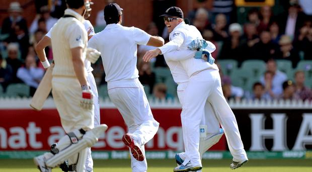 England's Graeme Swann (right) celebrates taking the catch of Australia's George Bailey (left) during day one of the Second Test Match at the Adelaide Oval