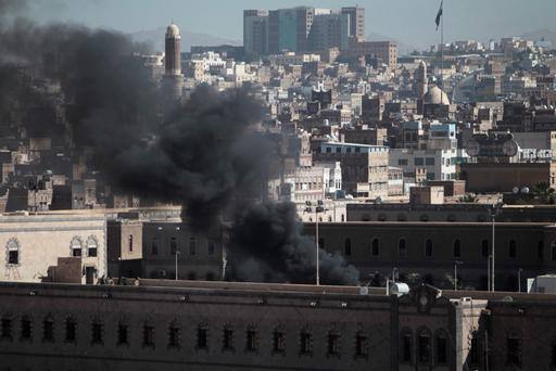 Smoke rises from the Defence Ministry's compound after an attack, in Sanaa, Yemen today