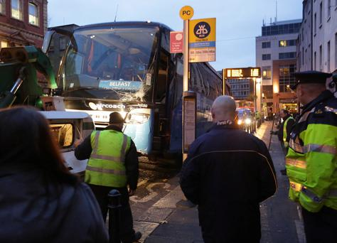 An Aircoach bus which was damaged when it collided with a lamppost on Parnell Square in Dublin. Photo: Damien Eagers