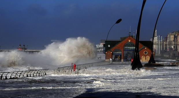 Blackpool Main Promenade under flood water following high tide and a tidal surge as severe gale force winds hit many parts of the UK