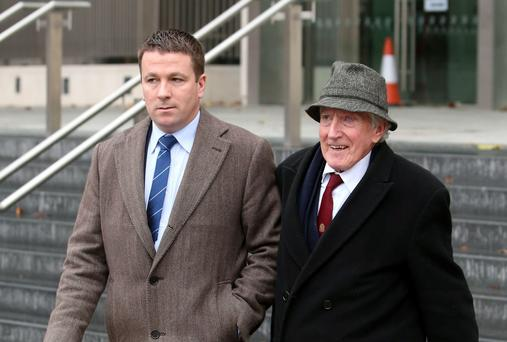 Ruairi O Ceallaigh and his father Sean O Ceallaigh leaving Dublin District Court. Photo: PA