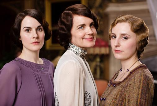 A Downton Abbey scene featuring Michelle Dockery, Elizabeth McGovern and Laura Carmichael