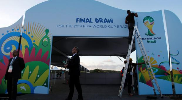 Workers prepare the entrance to the Costa do Sauipe where the draw for the 2014 World Cup will be held