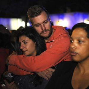 Mourners gather outside the home of former President Nelson Mandela in Johannesburg, South Africa Friday, Dec. 6, 2013 where Mandela died Thursday night after a long illness.