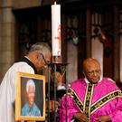 Former Archbishop of Cape Town Desmond Tutu (R) holds a mass at Cape Town's Anglican St George's Cathedral. Photo: REUTERS/Sumaya Hisham
