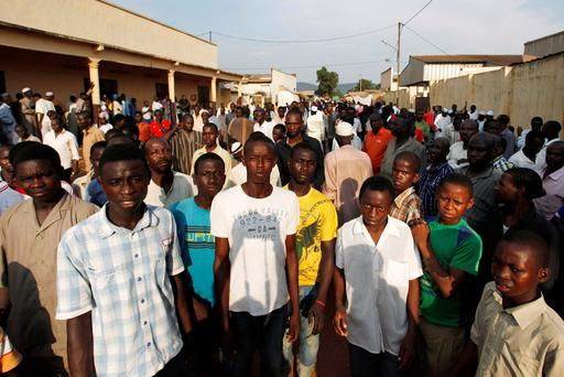 Residents of PK5, a largely Muslim neighborhood, congregate near a mosque where bodies of people killed during fighting are gathered in Bangui, Central African Republic