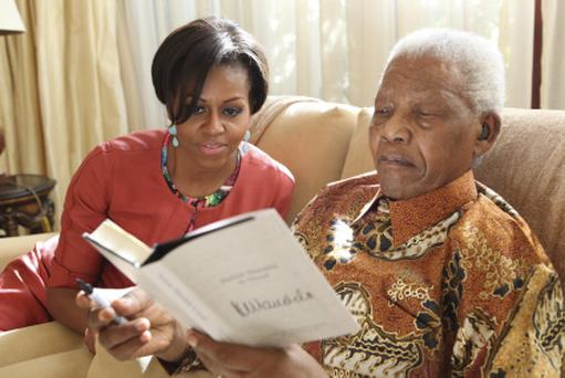 U.S. first lady Michelle Obama and former South African President Nelson Mandela in 2011