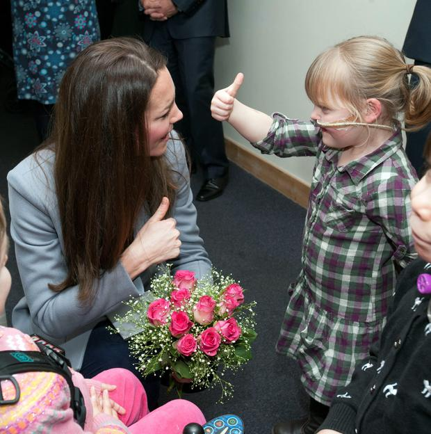 Kate Middleton meeting Demi-Leigh Armstrong, 5 (right) while visiting the Shooting Star House, a children's hospice in Hampton