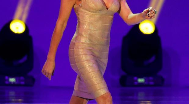 Model Fernanda Lima walks on stage during the draw for the 2014 World Cup at the Costa do Sauipe resort in Sao Joao da Mata, Brazil