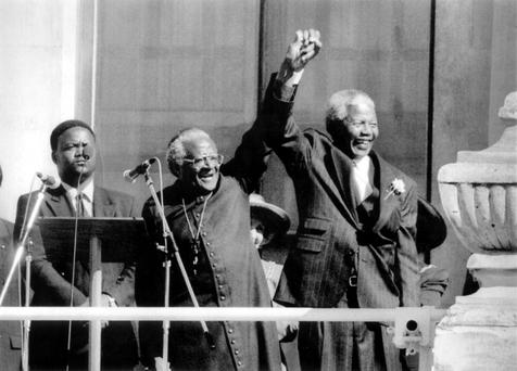 Nelson Mandela, right, and Archbishop Desmond Tutu in Cape Town, South Africa, celebrate Mandela's 1994 presidential victory.