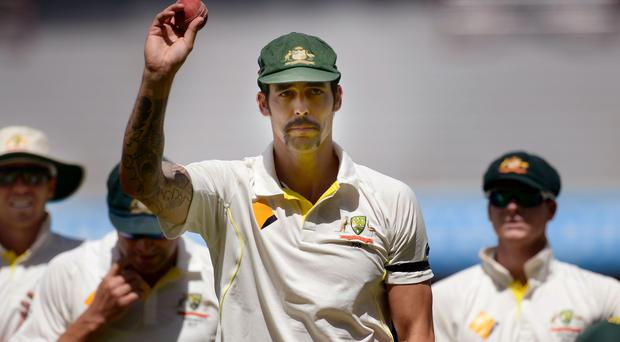 Australia's Mitchell Johnson leaves the field after taking seven wickets during day three of the Second Test Match at the Adelaide Oval