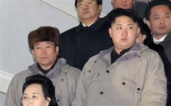 Jang Song-thaek (in hat) with North Korean leader Kim Jong-un