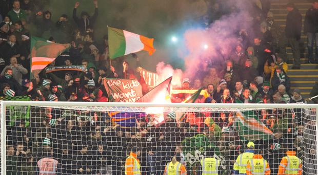 Celtic fans throw flares on to the pitch before the Scottish Premiership match at Fir Park last night