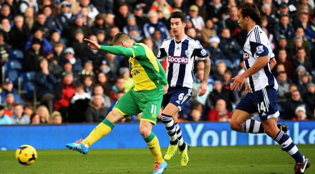 Gary Hooper of Norwich shoots and scores Norwich's first goal