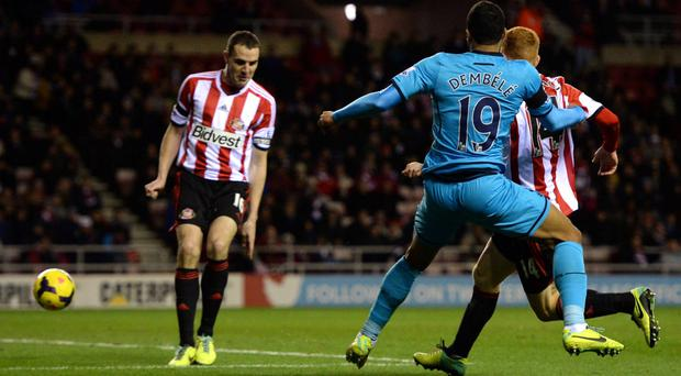 Tottenham Hotspur's Moussa Dembele kicks the ball which was deflected into goal by Sunderland's John O'Shea