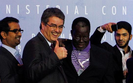 Director-General Roberto Azevedo gives a thumbs-up as he greets delegates after the closing ceremony of the ninth World Trade Organization (WTO) Ministerial Conference.
