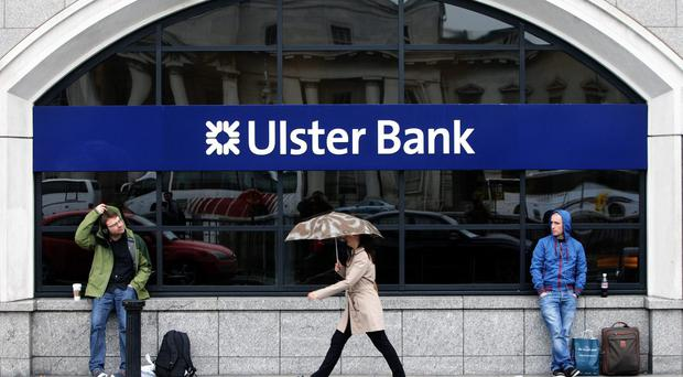People walk past Ulster Bank headquarters
