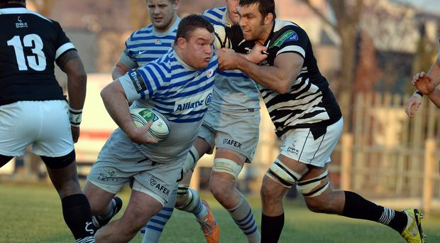 Quintin Geldenhuys of Zebre tackles Matt Stevens of Saracens