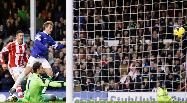 Everton's Gerard Deulofeu scores his side's first goal of the game during the Barclays Premier League match at Goodison Park, Liverpool.