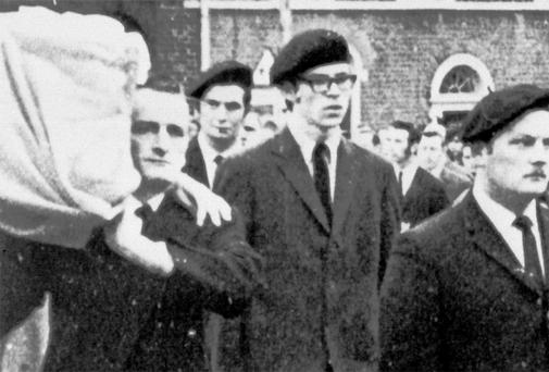 'NOT A MEMBER': Gerry Adams, centre, acting as a 'volunteer' for the IRA guard of honour at a funeral