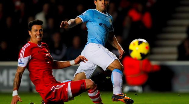 Southampton's Jose Fonte (left) is unable to stop a shot from Manchester City's Sergio Aguero