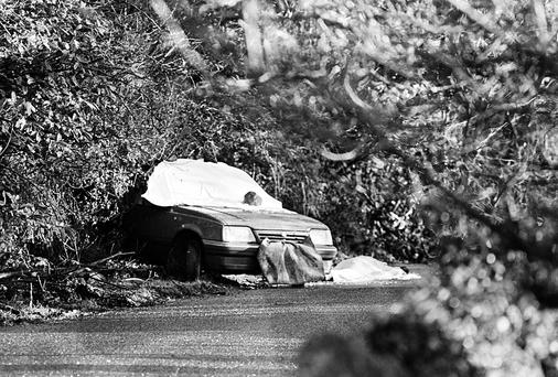 The scene following the IRA murders of senior RUC officers Harry Breen, left, and Bob Buchanan in south Armagh in 1989