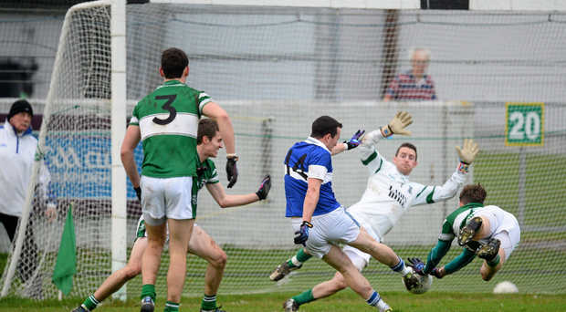 8 December 2013; Ciaran Dorney, St.Vincents, beats Portlaoise goalkeeper Michael Nolan and Kieran Lillis to score his side's first goal. AIB Leinster Senior Club Football Championship Final, Portlaoise, Laois v St Vincent's, Dublin, O'Connor Park, Tullamore, Co. Offaly. Picture credit: David Maher / SPORTSFILE