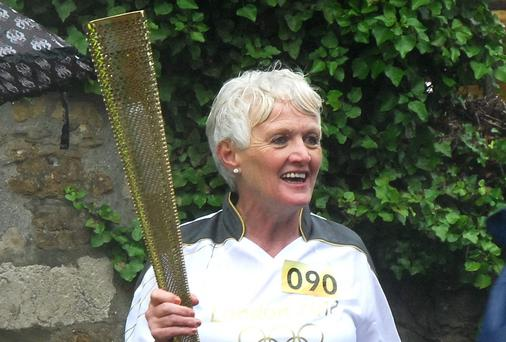 Mayo woman Margaret Moylan carrying the Olympic torch. She has now donated a kidney to her sister Rose.