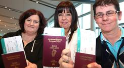 Dunnes Stores Workers of 1984 strike fame, Mary Manning, Liz Deasy and Karen Gearon pictured at Dublin Airport yesterday en route to South Africa for the funeral of Nelson Mandela. Photo: Colin O'Riordan