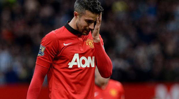 Manchester United's Robin van Persie looks dejected after the final whistle