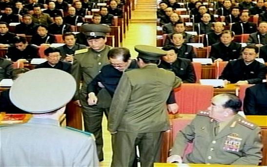 A screen grab from North Korea's Korean Central Television (KCTV) Broadcasting Station shows North Korean leader Kim Jong-un's uncle Jang Song-thaek being arrested