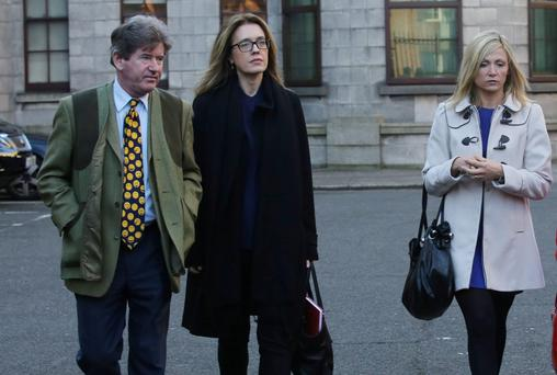 Tom Matthews, Mairead Lawless and Eilis Plunkett leaving court yesterday(Mon) after the High Court hearing. Photo Collins Courts