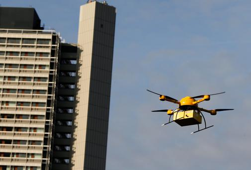 A Deutsche Post DHL prototype 'parcelcopter' takes to the air in Bonn