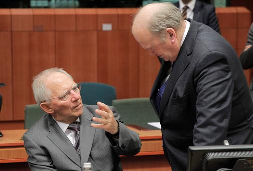 Germany's Finance Minister Wolfgang Schaeuble speaks with with Minister Michael Noonan in Brussels