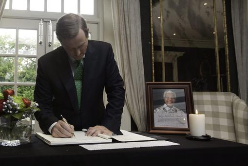 Taoiseach Enda Kenny TD & South African ambassador to Ireland Azwindini Jeremiah Ndou at The Ambassadors residence, Dublin where the Taoiseach signed a book of condolence in memory of Nelson Mandela. Photo: Gareth Chaney Collins