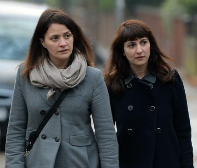 Sisters Elisabetta (left) and Francesca Grillo arriving at court.