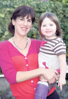 What's the rush? Emily Hourican with her daughter B at home in Stillorgan. Photo by Ronan Lang