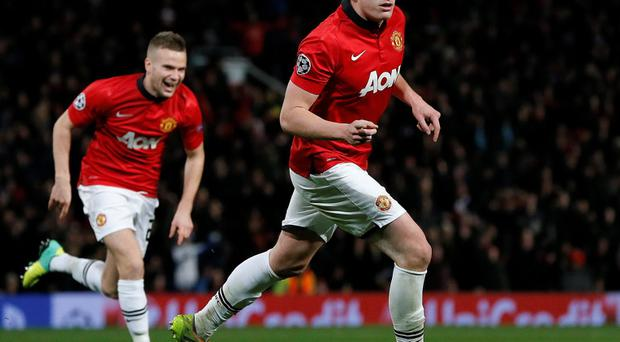 Manchester United's Phil Jones (R) celebrates scoring during their win tonight