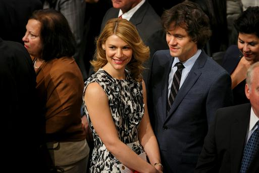 Actress Claire Danes (C) and her husband, British actor Hugh Dancy (centre R) are seen among the audience during the Nobel Peace Prize awards ceremony at the City Hall in Oslo