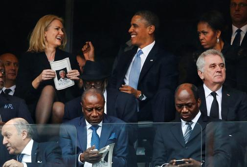 President Barack Obama jokes with Danish prime minister, Helle Thorning-Schmidt, left, as first lady Michelle Obama looks on