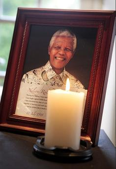 A picture of Nelson Mandela at the signing of the book of Condolence for Nelson Mandela at the Republic of South Africa Embassy in Ballsbridge yesterday. Photo: Tom Burke