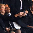 Michelle Obama did not appear pleased at her husband joining in the photo.