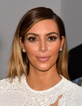 Kim was criticised for giving only ten per cent of proceeds to natural disaster sufferers.
