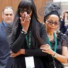 British supermodel Naomi Campbell reacts after viewing the coffin of former South African President Nelson Mandela.
