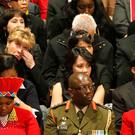 Mourners react during remarks by U.S. Vice President Joe Biden during a National Memorial Service for Nelson Mandela at the National Cathedral in Washington